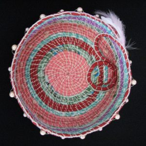 A pink, purple, pale blue and green coil basket.  This shows  what you can make using our tutorial.