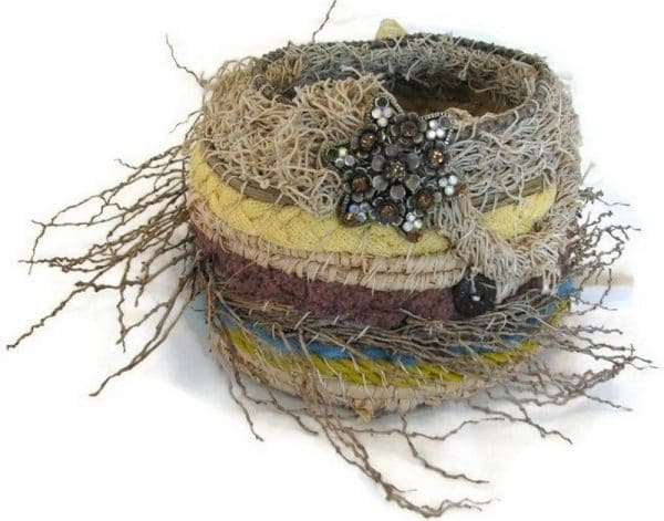 Ghost netting, palm inflorescence, fabric and raffia basket