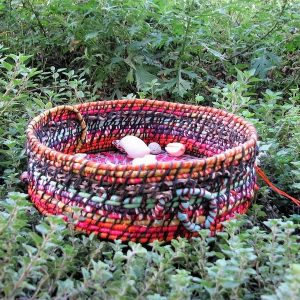 Handmade commission basket Multicolored coil basket with palm inflorescence