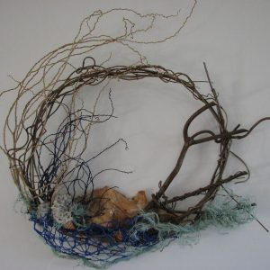 Wall art using natural materials including palm inflorescence and soft coral