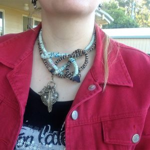 Two neck cord necklaces, brown and pale blue.